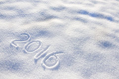 Silvester 2016 in snow. New year date 2016 written in snow Stock Photos