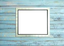SilveVintage picture frame on blue wood background Stock Image