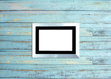 SilveVintage picture frame on blue wood background Stock Images