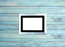 SilveVintage picture frame on blue wood background Stock Images