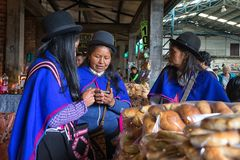 Traditionally dressed guambiano women in the local market royalty free stock photography