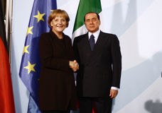 Silvio Berlusconi, Angela Merkel. OCTOBER 6, 2008 - BERLIN: Italian Prime Minister Silvio Berlusconi, Chancellor Angela Merkel at a press conference after a Stock Images
