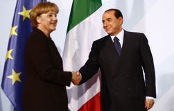 Silvio Berlusconi, Angela Merkel. OCTOBER 6, 2008 - BERLIN: Italian Prime Minister Silvio Berlusconi, Chancellor Angela Merkel at a press conference after a Royalty Free Stock Photos