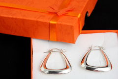 Silwer earrings present. Silver earrings in box present jewelery Royalty Free Stock Images