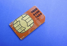Sim card. Over blue background Stock Photos