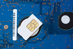 Sim card. The sim card is located on an electronic payment of the winchester of the laptop Royalty Free Stock Photo
