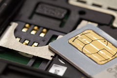 Sim card. On cell phone Stock Photography