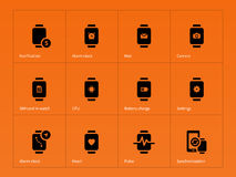 SIM card and CPU in watch icons on orange Royalty Free Stock Photography