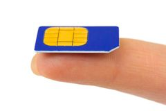 Sim card on finger Royalty Free Stock Images