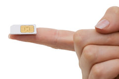 Sim card In a hand. Isolated on white background Stock Images