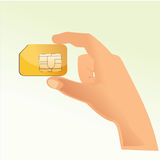 Sim card with hand Stock Photo