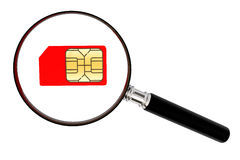 SIM card and magnifier Royalty Free Stock Image