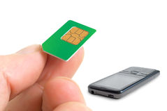 Sim card and  phone. Stock Photography