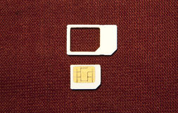 SIM card micro  on brown Stock Photography