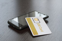 SIM card and mobile phone Stock Photo