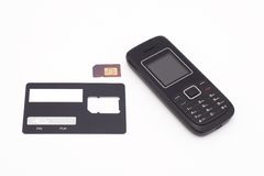 SIM card and mobile phone Stock Images