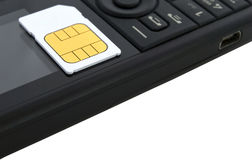 Sim card on mobile telephone Royalty Free Stock Image