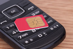 SIM Card over the Phone Royalty Free Stock Photo