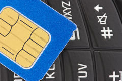 Sim card on  the  phone Stock Photo