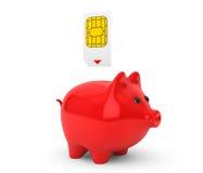 Sim Card Putting nel porcellino salvadanaio Fotografie Stock Libere da Diritti