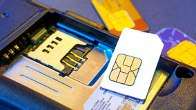 Sim card. Ready to change sim card on smartphone with blank new one stock images