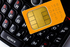 Sim card on smart phone. Keyboard Royalty Free Stock Photos
