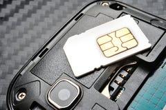 SIM card. On the smart phone Stock Image