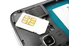 SIM card. On the smart phone Royalty Free Stock Images