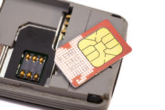 SIM card on smart phone Royalty Free Stock Images