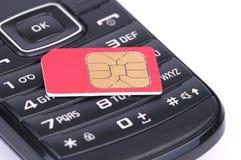 SIM Card sopra il telefono Fotografie Stock