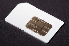 Sim Card su fondo nero Fotografie Stock