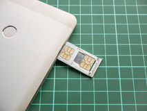 SIM Card Tray Filled with Nano SIM Card and Micro SIM Card. In Smartphone Royalty Free Stock Photo