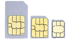 Sim cards. A close up picture of one mini-sim, one micro-sim and one nano-sim Stock Photography