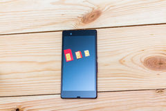 SIM cards of different form factor on the smartphone Royalty Free Stock Photos