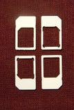 SIM cards micro  on brown Stock Image