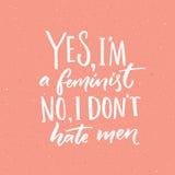 Sim, eu sou uma feminista nenhuma, mim não odeio homens O slogan do feminismo, vector citações escritas à mão no fundo cor-de-ros ilustração royalty free