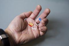 SIM-In Hand kaarten Royalty-vrije Stock Foto's