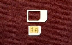 SIM karty mikro na brązie Fotografia Stock