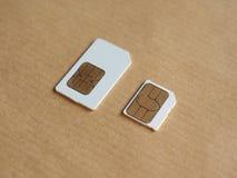 SIM- och USIM-kort som används i telefoner Royaltyfria Foton