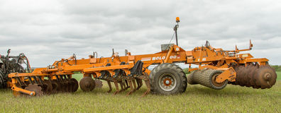 A simba cultipress solo 600 farm machinery. A orange A simba cultipress solo 600 plough roller and roll rings farming machinery Royalty Free Stock Image