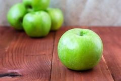 Simbirenko`s green apples on a wooden table Royalty Free Stock Images