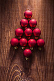 Simbol of fir tree from composition of red christmas balls on ol Royalty Free Stock Image