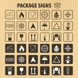 Simboli d'imballaggio di vettore sul fondo del cartone L'icona di trasporto ha messo compreso il riciclaggio, fragile, la durata  royalty illustrazione gratis