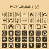 Simboli d'imballaggio di vettore sul fondo del cartone L'icona di trasporto ha messo compreso il riciclaggio, fragile, la durata  Fotografia Stock