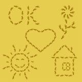 Simboli dall'orma sulla sabbia Immagini Stock Libere da Diritti