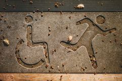 Simboli del corridore e disabili immagine stock