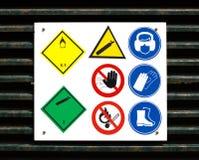 Simboli di sicurezza e di rischio sul portello fotografia stock libera da diritti