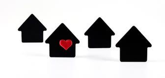 Simboli neri della casa su fondo bianco Fotografie Stock