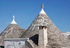 Simboli sui tetti di Trulli, Alberobello Fotografie Stock Libere da Diritti