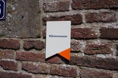 Simbolice la indicación de un monumento protegido en los Países Bajos fotos de archivo